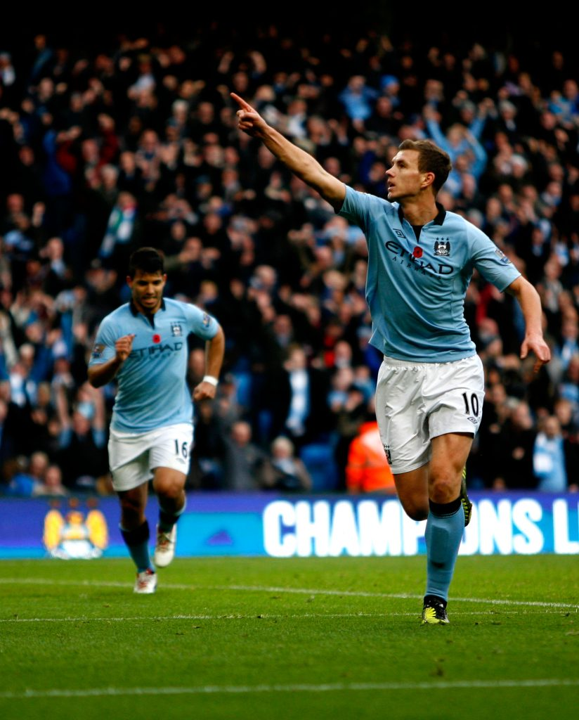 DHX1PJ Edin Dzeko celebrates after scoring against Tottenham Hotspur at the Etihad Stadium in the English Premier League