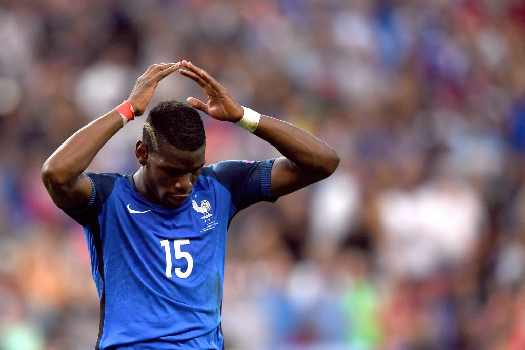 GD100W Paul Pogba of France reacts during the UEFA EURO 2016 soccer Final match between Portugal and France at the Stade de France, Saint-Denis, France, 10 July 2016. Photo: Federico Gambarini/dpa