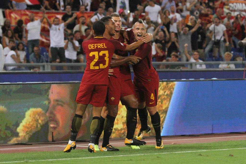 K1RRM8 Rome, Italy. 26th Aug, 2017. Edin Dzeko, Gregoir Defrel, Radja Nainggolan and Juan Jesus of AS Roma celebrate during the Serie A match between AS Roma and FC Internazionale on August 26, 2017 in Rome, Italy. Credit: Paolo Pizzi/NEWZULU/Alamy Live News